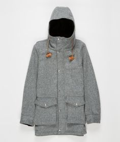 Monitaly Hooded Parka made from 100% pure virgin wool. Outer pockets are gusseted with 'snap stay' at the opening. Inside the hood and under cuff are lined with corduroy. Front has a zipper closure and wind flap with snaps.