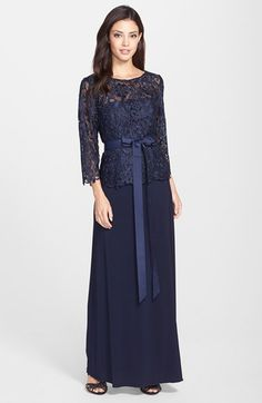 Free shipping and returns on Patra 'Venice' Lace & Jersey Mock Two-Piece Gown at Nordstrom.com. Beautiful floral lace is crafted into the three-quarter sleeves and bodice atop this lovely jersey gown, lending a sophisticated mock two-piece style. A wide, lush ribbon encircles the waist to nip in the narrowest point of you.