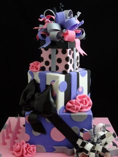 http://cakecentral.com/gallery/2406616/gift-stack-cake