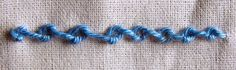 knotted chain stitch  http://www.embroidery.rocksea.org/stitch/chain-stitch/knotted-chain-stitch/