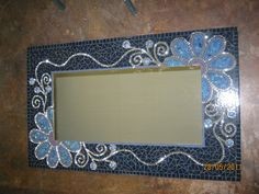 Mosaic flower mirror by Lisa B