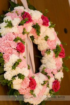 Pink & white carnations with pink roses.  Wedding flower wreath. via @Neil Boyd Photography