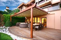 Attached Modern Pergola Design with Beautiful Lighting on Canvas Covers and Wicked Furniture on Wooden Deck