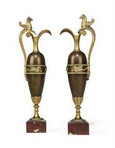 A PAIR OF EMPIRE ORMOLU, PATINATED BRONZE AND ROUGE GRIOTTE MARBLE EWERS  ATTRIBUTED TO CLAUDE GALLE, CIRCA 1810.