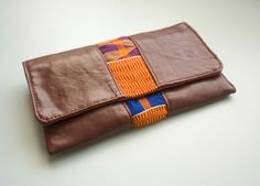 Leather and kente clutch from Kushn Handmade Leather Goods