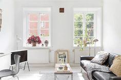 string shelf in scandinavian apartment, white painted floor, spacious interior