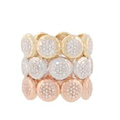 The perfect eternity band, by Phillips House, blending luxury with individuality. Made in 14k gold, the Affair Disc band features a full set of hammered matte pave diamond discs reaching around the entire ring. Each ring features 152 diamonds, 0.57 tcw. Available at London Jewelers!