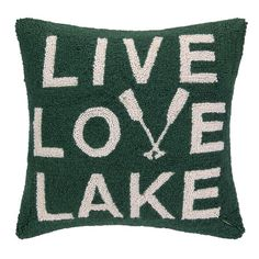Bring lake house charm to your den or guest room with this hand-hooked wool pillow, showcasing bold typography.  Product: Pillow...