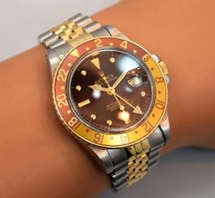 "Check out the bewitching patina on this 18K yellow gold and stainless steel, Rolex ""Root Beer"" GMT, Ref. 16753 from 1982. The brown dial is turning a rich purple hue. Exquisite (Store Inventory# 9778, listed $6500)! #rolex #gmt #rootbeer #patinateddial #exquisite #watches #vintagewatches #stawc"