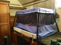 BabyBjörn travel crib fits fairly well on the kids' bed/table, and stows equally as well underneath.