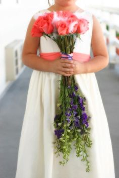 """Salmon (""""Movie Star"""") Roses and Delphinium, lovely. It was perfect to hold."""