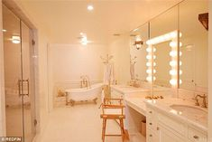 Spa serenity:The master's bathroom takes inspiration from yesteryear with an area to sit down and apply makeup between the double vanities as well as a clawed tub and separate shower