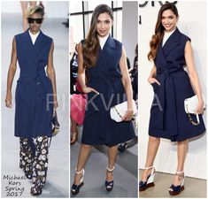 She wore a navy blue trench dress from Kors' Spring 2017 collection, that she paired with high neck top. Colour block wedges, winged liner and cascading curls rounded her look out.