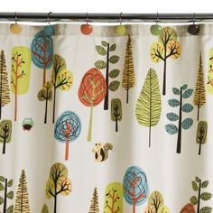 2 of these fabric shower curtains, layered with brown cotton curtains, made fun curtains for our baby's room!