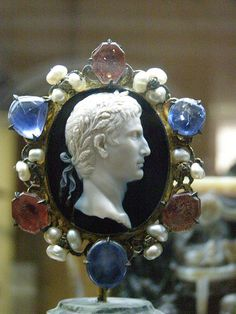 Cameo of August Attributed to  the engraver Dioscoride Sadonyx,Rome,About 25-20 BC Mounting,14th cent.silver,sapphires,red doublets,lozenge of pearls. Treasure of the Abbey of Saint Denis Museum of Coins,Medals and Antiques,Paris