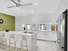 Verto Kitchens   Helensvale Streamlined kitchen with a feature wall. Love the small windows letting the outside in. Small Windows, Quality Kitchens, Bespoke Kitchens, Wall, Furniture, Home Decor, Decoration Home, Room Decor, Walls