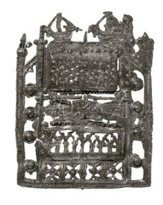 Pilgrim badge from the shrine of St Thomas Becket at Canterbury Cathedral. This openwork badge represents Becket's shrine itself (Becket's remains had been moved to a magnificent new shrine at the east end of the cathedral in 1220). The base of the badge is decorated with cusped niches. Above this is a figure of Thomas Becket, lying down, his hands joined in prayer. Production Date: Late Medieval; mid-late 14th century