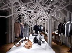 Suppose Design Office has just completed there interior design for  the Diesel Denim Gallery Aoyama in Tokyo, Japan. The installation, called Nature Factory is made out off plastic plumbing pipes and joints to create a series of tree-like forms inside the store.
