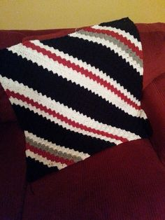 Crochet Corner to Corner Baby Afghan in the New England Patriots colors.