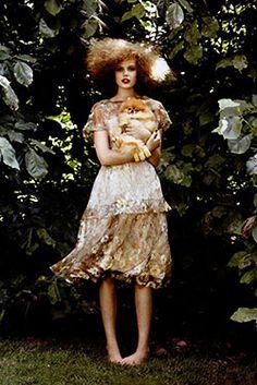 Frida Gustavsson and her pomeranian. Vogue November 2010