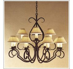 "7070-38  TWELVE LIGHT TWO TIER IRON CHANDELIER FINISH SHOWN: PUEBLO SHADE: 3X7X4 WITH WHITE WAX CANDLES MAXIMUM WATTAGE: 720 CANDELABRA BASE SOCKETS HT 31"" W 38"""