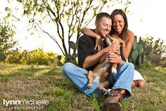 Country chic engagement portraits.  Cowboy boots. Puppy dog. Cactus.