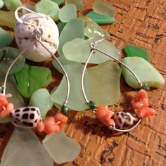 """Sterling Silver Hawaiian Shell Hoops Hawaiian Hebrew cone shell, pink coral and tiny emeralds all wired wrapped on sterling hoops. Shells found on the beaches in Hawaii. Earrings are 13/4""""x1"""". Jewelry"""