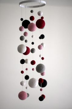 Felt Ball Mobile in Pink and Grey on Etsy, $75.00. Can order custom colors