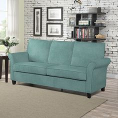 The Portfolio Home Furnishings Radford SoFast sofa features a a rolled, welted flair arm that can be assembled in less than 2 minutes. The ultra comfortable Radford sofa is covered in a soft turquoise