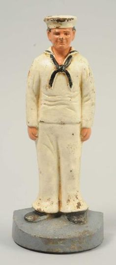 By John Wright. Full-figure, solid casting of sailor dressed in whites.