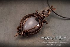 Symbols  'The blossom is a symbol of spring'  Lovely Rose Quartz Heart Gemstone w/ a Czech Crystal Bead Wire Wrapped in an Antiqued Copper Finish. Comes with Adjustable 16-19 Brown Leather Corded Chain.   Perfect for much awaited Spring!  Pendant:  3  x 1 -1/2  Chain Cord: 16-19  Domestic