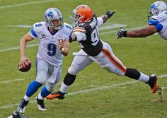 Detroit Lions quarterback Matthew Stafford (9) avoids the rush from Cleveland Browns defensive end Armonty Bryant