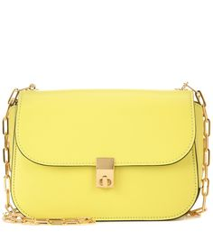 Valentino - Valentino Garavani Chain leather crossbody bag - Valentino Garavani's Chain crossbody bag has been crafted in Italy from canary yellow leather. The compact style will hold your essentials – think wallet, phone and lipstick. Enhanced by stunning golden hardware, this piece will add a dash of colourful charm to pared-back ensembles. seen @ www.mytheresa.com