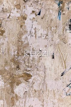 scratched poster on concrete wall. - Detailed shot of peeled advertisement poster on concrete wall.