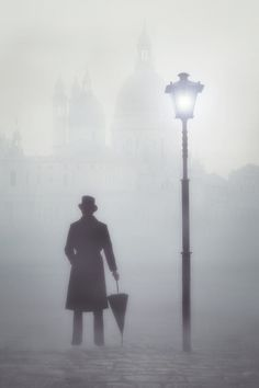 a victorian man with a top hat and an umbrella next to a street lamp in fog in front of a church Victorian London, Victorian Men, Vintage London, Victorian Fashion, Storyboard, Ville Steampunk, Arte Black, Night Circus, Fallen London