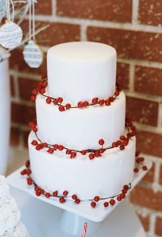 Three-tiered White Winter Wedding Cake with Berry Garland....pretty simple but timeless