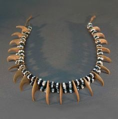"Africa | A rare and beautiful Zulu ""lion's claw"" necklace with black & white Venetian beads. 