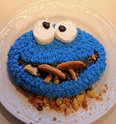 Cookie Monster Cake - so adorable!  blue sprinkles, chocolate chip mouth, marshmallow eyes, cookies