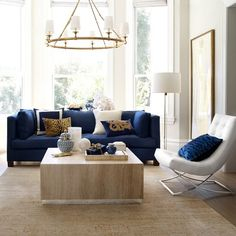 Navy sofa, white chair, natural fiber area rug, gold accents Sofas & Loveseats   Williams Sonoma