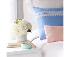 Add a touch of lace to your favorite home decor such as throw pillows, vases, and more.