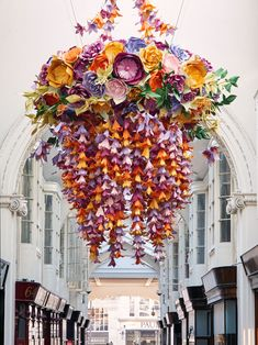 """ZOE BRADLEY DESIGN,UK, """"Creates two paper sculptures/chandeliers for Burlington Arcade,London"""",(1,860 flowers made up from 9,676 petals and 2,100 leaves),  pinned by Ton van der Veer"""