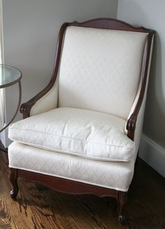 After - French Chair.  I stripped the white finish off, took off all the old green velvet fabric, sanded and stained the wood, and had my favorite reupholsterer work his magic adding all new fabric.  Voila!