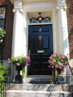A beautifully polished lion's head knocker on a glossy black door conveys confidence and status