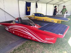 Red One and Aurum sit in having a well-earned rest. Solar Powered Cars, Solar Car, Rest, Challenges, World, Vehicles, Car, The World, Vehicle