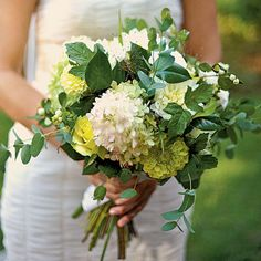 Foliage from the yard adds a loose and casual feel to the bouquet