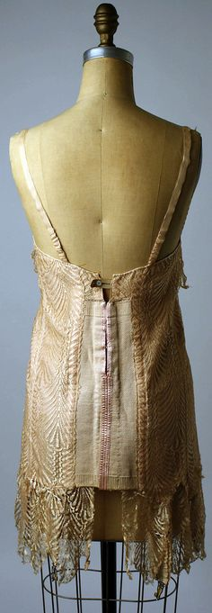ceci est un corset. si ! Bienjay, France (made by) for Saks Fifth Avenue 1920-25. Nude/Peach silk corset. Cotton/silk and rubber. Back view. *vintage leavers*