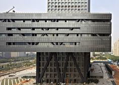 The Shenzhen Stock Exchange - a skyscraper with a skirt by OMA