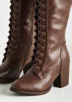 As your favorite sci-fi novel begins to get good, you tap the heels of your faux-leather boots in excitement. The more immersed you become, the more you imagine these knee-high boots trotting through the plot - their brown tone and lace-up fronts adding to the story's intrigue!