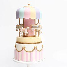Cutest carousel cake @cuppyandcake