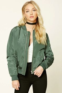 A padded bomber jacket featuring a zip-up front, quilted lining, two front flap snap-button pockets, ribbed trim, zippered pocket on left arm, and long sleeves.